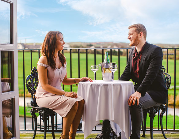 Two people drinking champagne al fresco in the Master Distiller's Suite at The Bushmills Inn